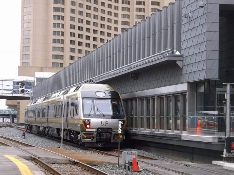 A Union-Pearson express train parked in a train station.