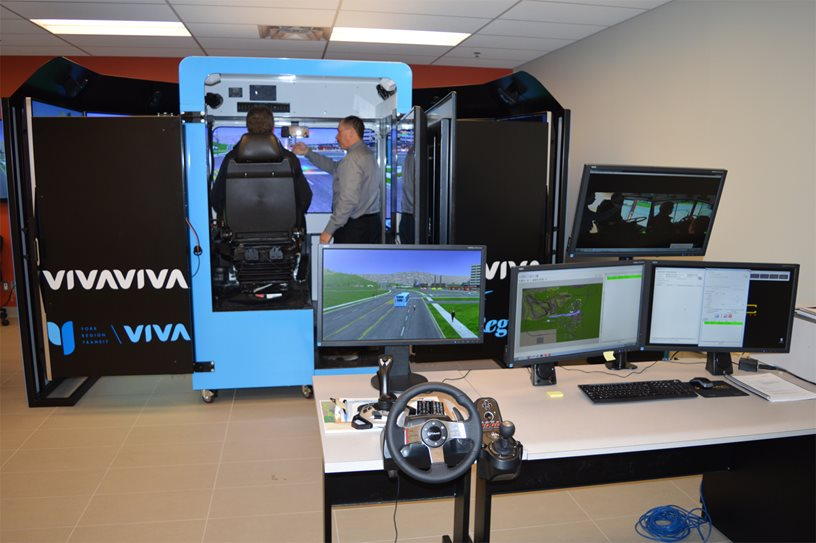 Employees being trained on the York Region Transit Bus and Snowplow simulator.